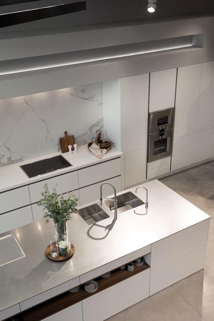 SieMatic PURE in lotus white, inox worktop, appliances Gaggenau