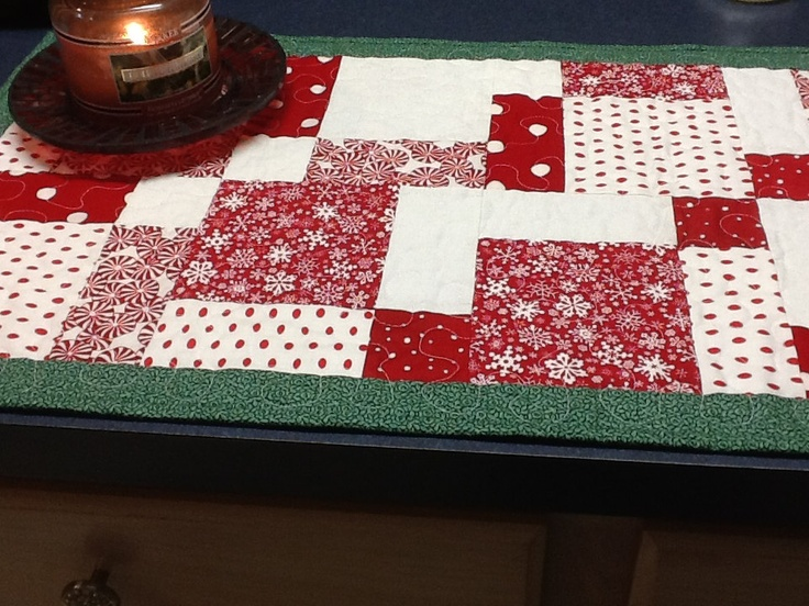 Red and White Christmas Table Runner With Green Border. $25.00, via Etsy.