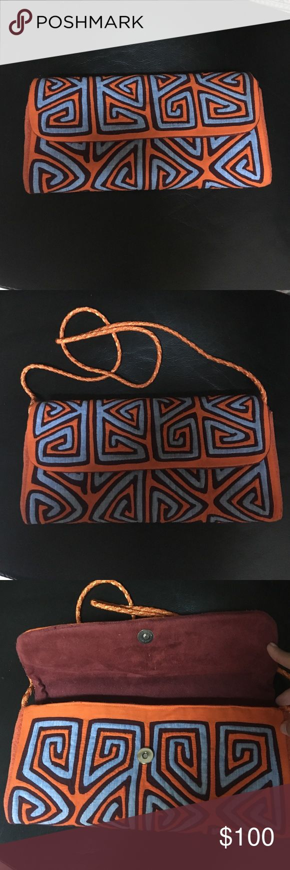 Mola clutch hand made and gorgeous! This Orange and blue with burgundy accents mola clutch will be the hit at your holiday parties! All hand made by artisans in Colombia. Price is firm! Measures 12x6.5x2 in. by_ivonneh Bags Clutches & Wristlets