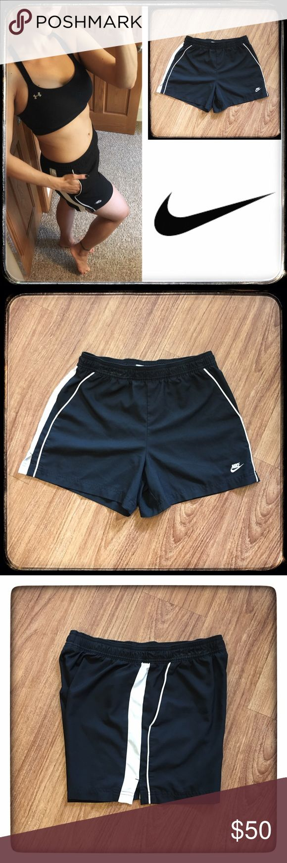 """Nike women's black & white shorts w/ pockets 📦Same day shipping (as long as P.O. is open for business). ❤ Measurements are approximate. Descriptions are accurate to the best of my knowledge.  These classic black and white track shorts from Nike feature the Nike logo on the front with white piping and a white stripe down each side as well as 2 front pockets. 100% polyester. Elastic waist (drawstring is missing). Flat measurements: 13.5"""" across waist, 10.75"""" rise, 4""""inseam. Excellent…"""