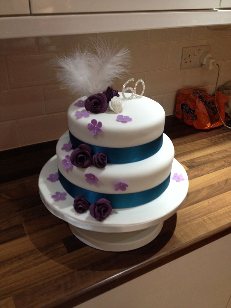 60th birthday cake with peacock colours