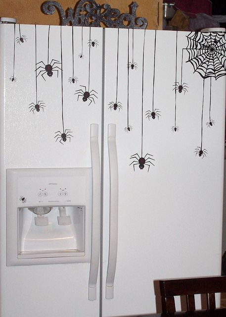 VINYL Spiders for the fridge. Made with the SILHOUETTEcutting machine and designs (no other info)