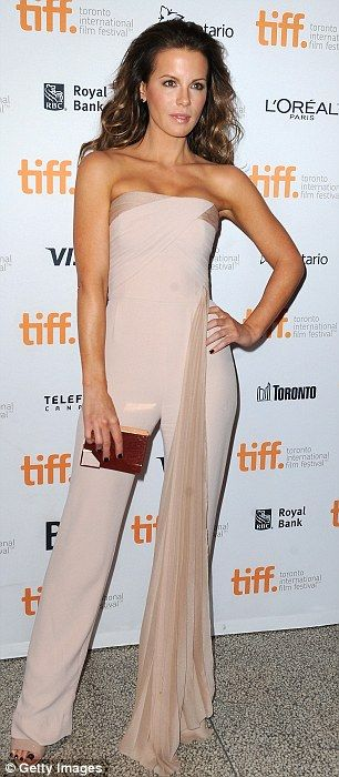 Best dressed @ 2014 Toronto Film Festival | Kate Beckinsale in an Azzaro blush jumpsuit paired with Brian Atwood sandals and a Lee Savage metallic gold clutch