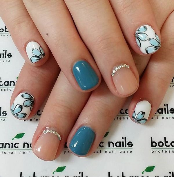 Simple yet very cute short winter nail art design. Combine clear polish with blue green, sky blue and white colors to create this soft and pretty floral nail art design with embellishments.