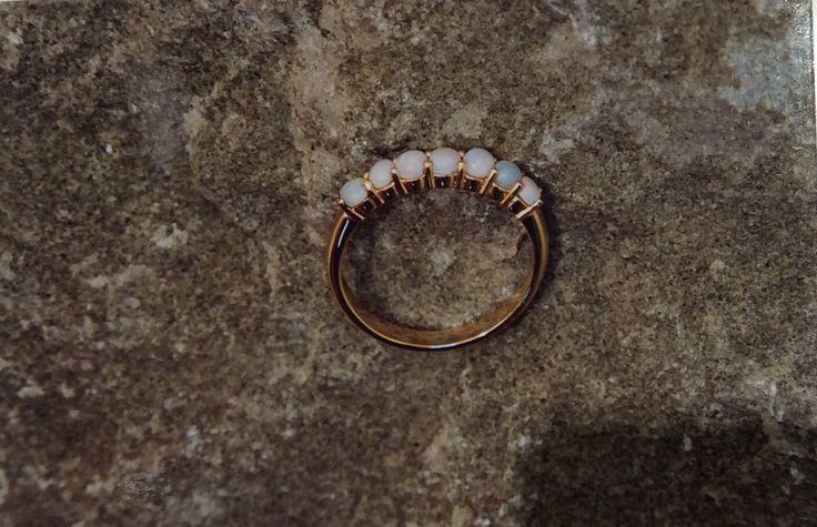 Simple bridge desighn featuring pillar claws including 7 round milk opals