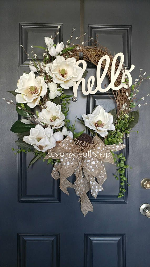 Signature Magnolia Wreath, Spring Magnolia Wreath Magnolia wreaths are one of the most beautiful foliage in nature. This elegant magnolia wreath incorporates large, realistic, artificial magnolia flowers and leaves on a grapevine oval base. A tasteful and elegant front door wreath