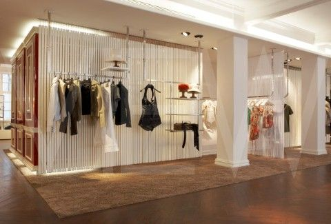 DIESEL FLAGSHIP STORE, LECKENBY ASSOCIATES, 2007, LONDON, VIEW OF HANGING RAILS WITH CLOTHING / c: Ed Reeve