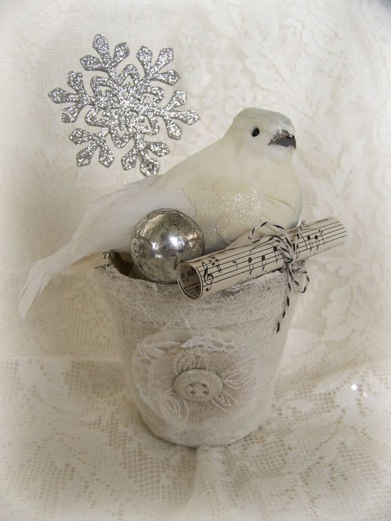 Shabby White Christmas at its best! Set in a white-washed pot, this festive white dove, vintage look sparkly snowflake, tarnished silver ball , and