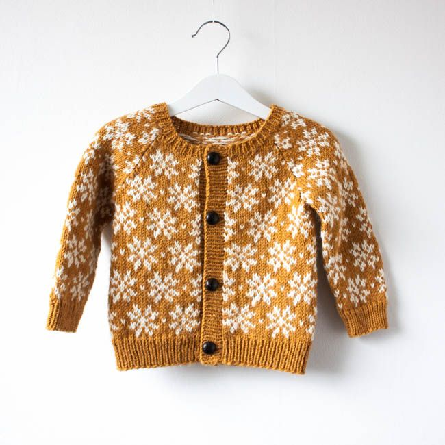 A baby and toddler knitting pattern to make a colour work cardigan, the cardigan is knit in the round and steeked open.