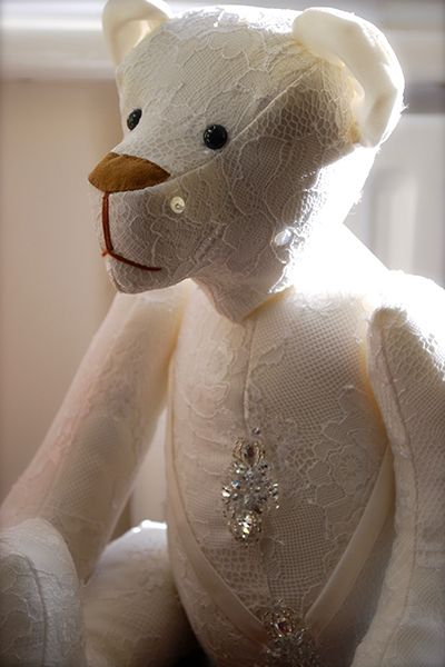Transform your wedding gown into beautiful keepsake teddy bears, like this one by Bowman Bears, that can be passed down to your children.