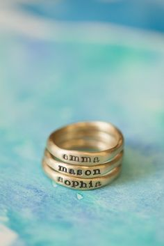 Personalized Stacking Rings by Lisa Leonard! Custom made & full of meaning. Hand-molded and cast in 10k gold, these rings have a beautiful organic shape and feel. Each ring has a hammered texture. Customize your ring with a special name or short phrase and stack them up !