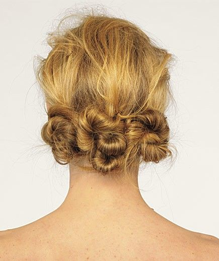 Perfect for a muggy, rainy day, this triple knot style keeps hair in place and off your neck.