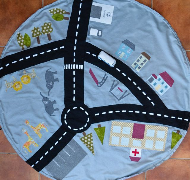 Learn how to make a car play mat that folds up into a drawstring storage bag. Tutorial by Vicky Myers Creations.