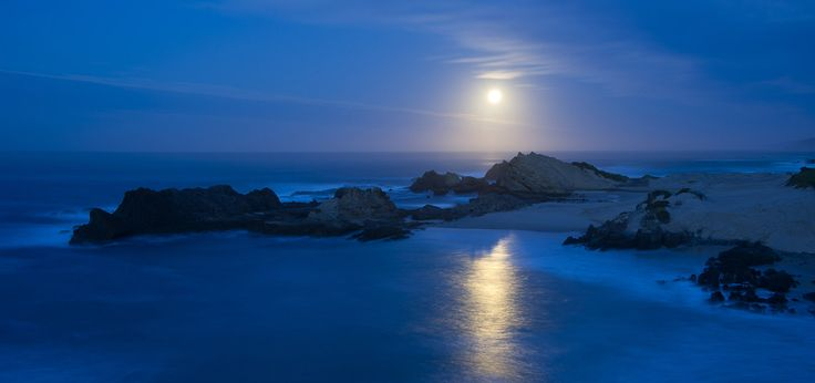 Full moon setting. Garden Route. South Africa.