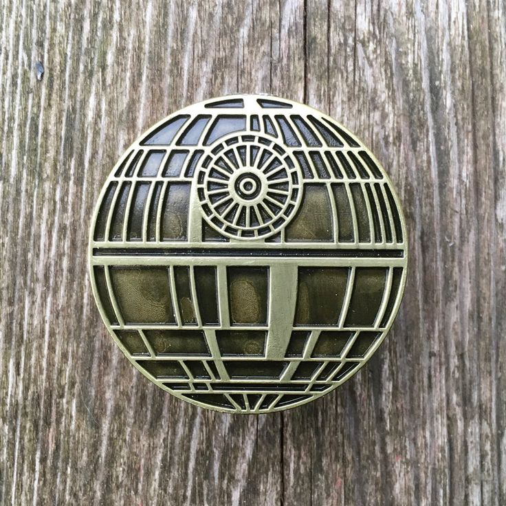 Death Star Drawer Knobs in Brass. These drawer knobs are perfect for a Star Wars themed room. Use them on a dresser or on cabinet doors.
