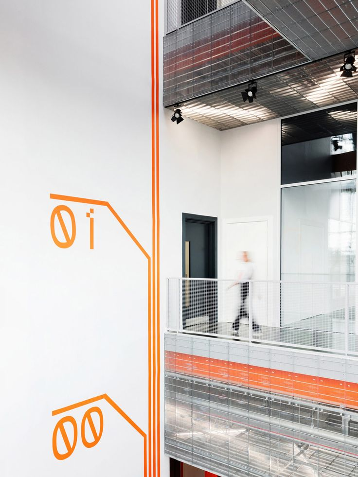 Wafinding system designed by dn&co. for commercial space and tech hub Here East