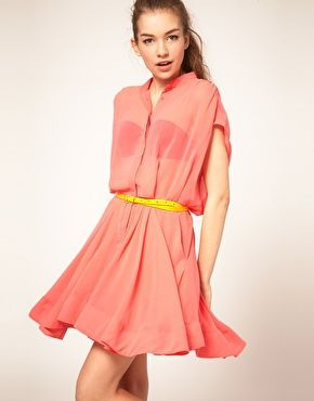 Wear bright sheer top with matching bra top and contrasting accessories