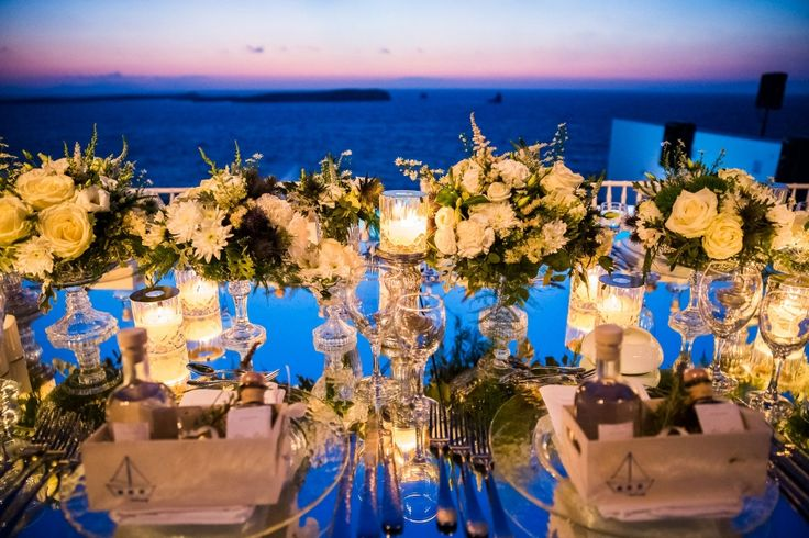 The perfect setting! Wild reflections of the Aegean during sundown, white roses, hydrangeas and lysianthus.