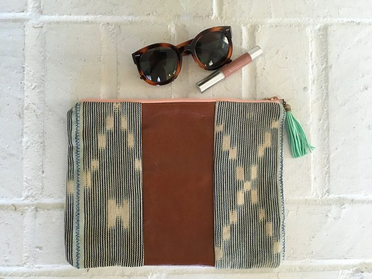 Handsewn Clutch with Tassel Accent
