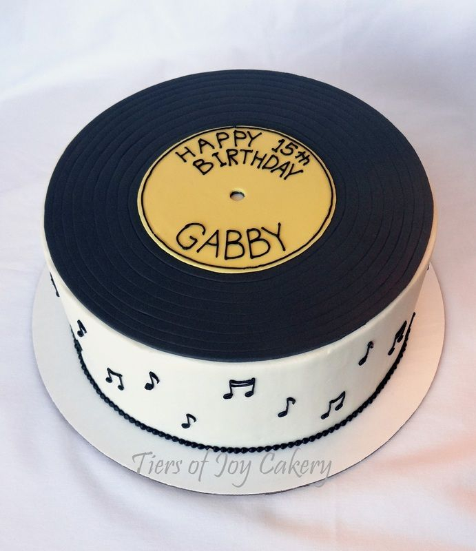 Musical birthday cake with a fondant record on top.