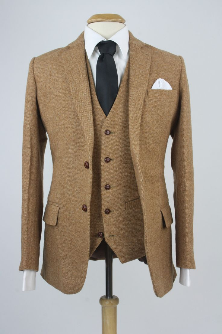 """Custom three piece suit features Herringbone pattern Brown 100% soft wool tweed Two buttons down the front Five buttons on vest Rear adjustable strap Flat front pants 6"""" differential on pants"""