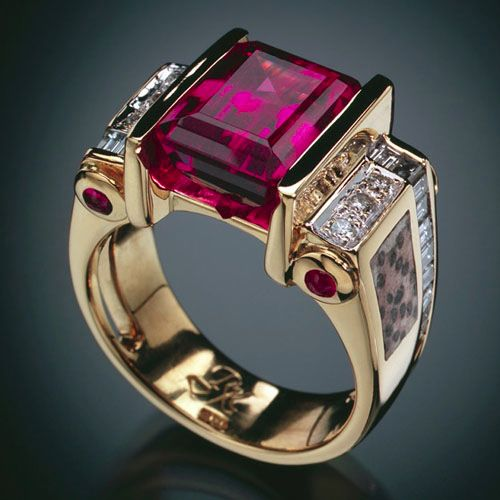 Similar to the one Roger gave me for our 25th Anniversary.  Mine is a large garnet, and the inlayed stone on the sides is petrified dinosaur bone from Vernal, Utah.  Cool!