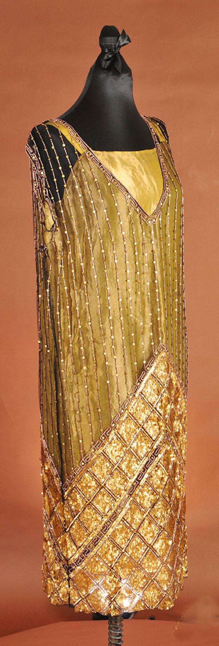 An olive-green sheath with sequin details, circa 1920s, is one of the items that will be on display at the University of Missouri Department of Textile and Apparel Management's History's Closet II fundraising exhibit.