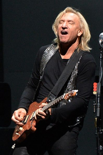 "Joe Walsh of the Eagles performs during ""History Of The Eagles"" Live In Concertat the Bridgestone Arena on October 16, 2013 in Nashville, Te..."