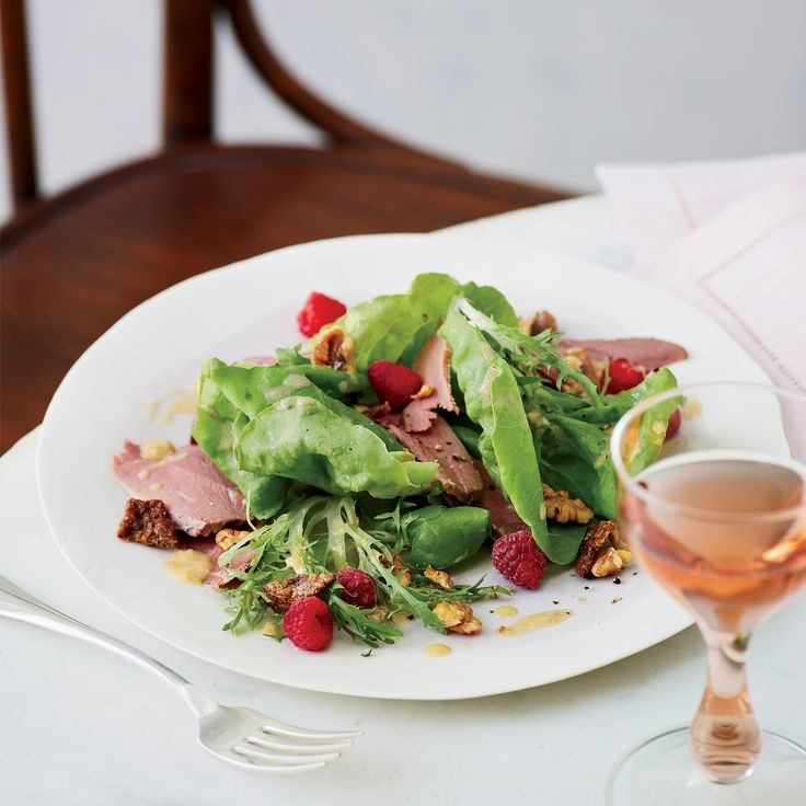 Traditional French flavors—duck breasts, cracklings, walnuts and nut oil—are paired with raspberries and frisée to make this completely original salad.