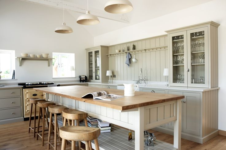 The Warwickshire Barn Shaker Kitchen by deVOL - A beautiful barn in leafy Warwickshire is the setting for this charming Shaker kitchen. The tongue and grooved panel is a new look for us which we think looks fantastic. The large bespoke island creates an impressive focal point in this family friendly kitchen.
