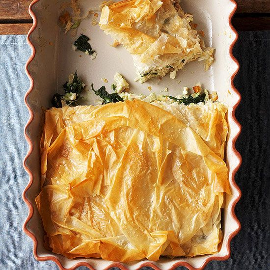 Chicken is the perfect way to make classic Greek spinach pie a party-worthy entree. Layers of buttery phyllo dough and a douse of feta cheese ensure ultrasavory flavor.
