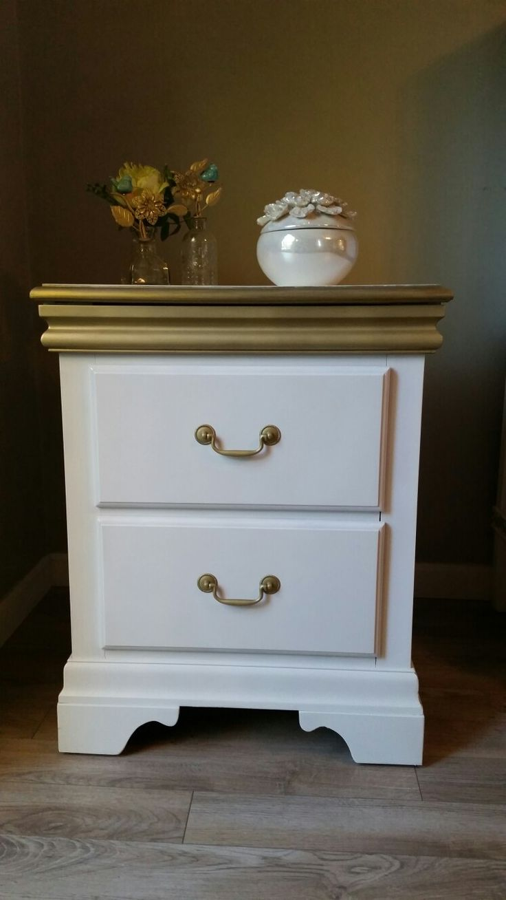 Cute Gold and White end table.