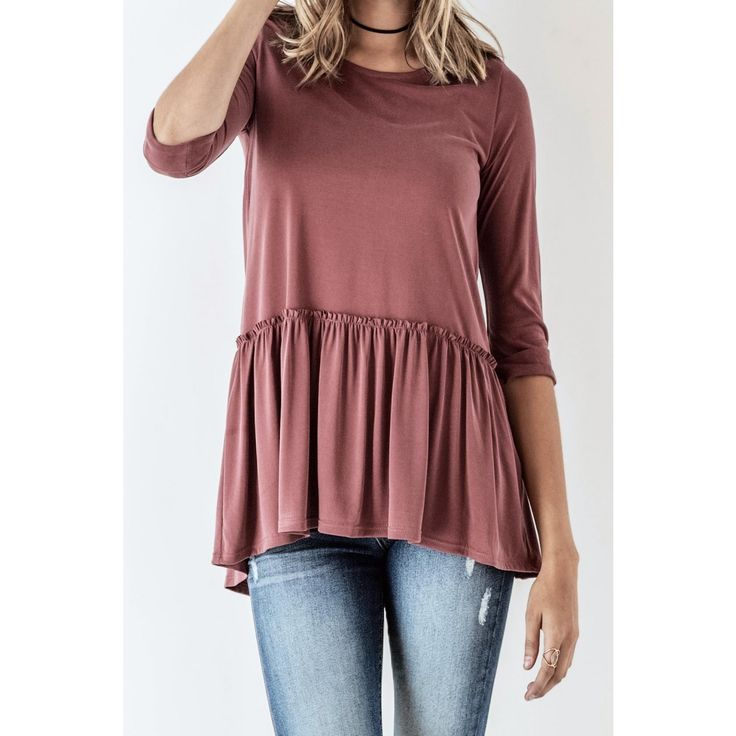 This washed mineral babydoll top features a three quarter-length sleeve and scoop neckline.