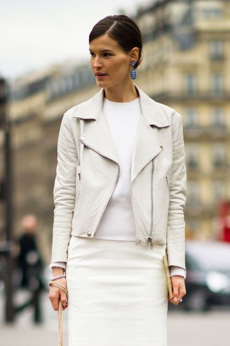 Hanneli wears an Acne jacket and skirt, Miu Miu earrings and shoes, and a Valentino bag in Paris.