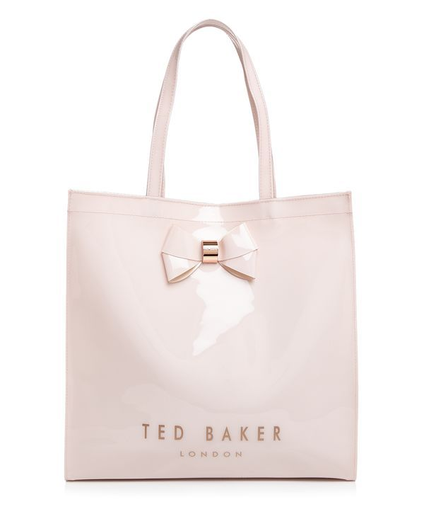 "With an oversized bow and patent finish, Ted Baker's streamlined logo shopper is just plain pretty. | PVC | Imported | Double handles   | Open top; unlined | Interior zip pocket | 14.5""L x 4.5""W x 14."
