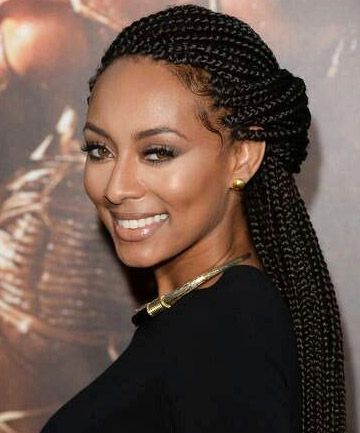 Kerri Hilson's take on the half-up/half-down look was just begging to be shared. The braids, pulled back away from her face, complement her slightly smoky eye makeup.