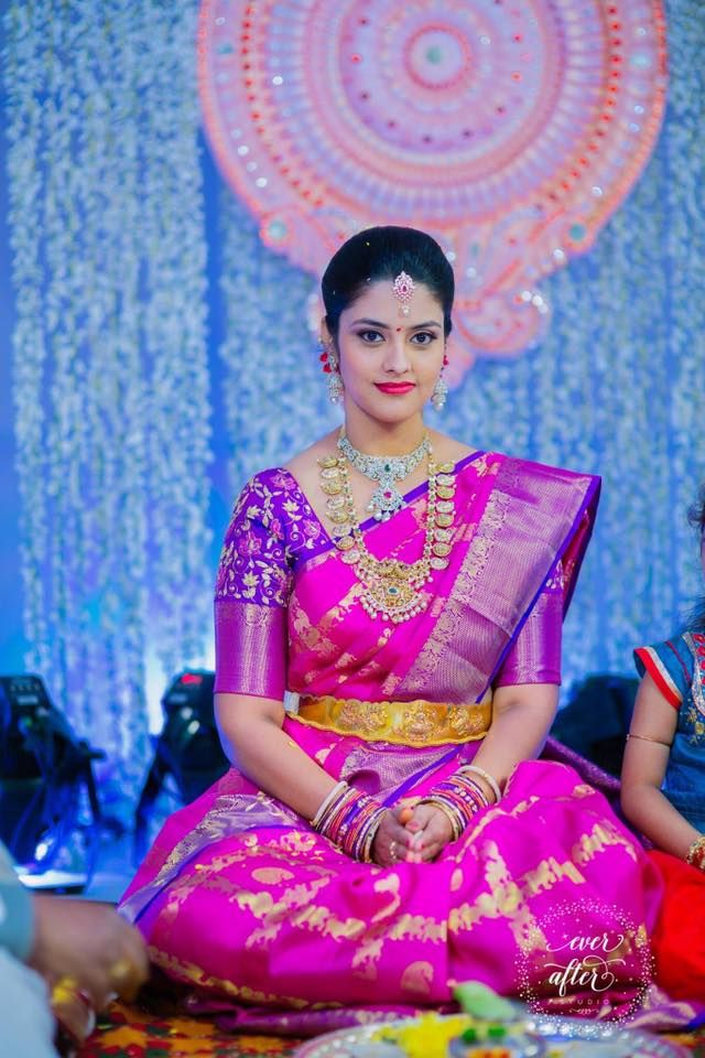 South Indian bride. Gold Indian bridal jewelry.Temple jewelry. Jhumkis.Pink and purple silk kanchipuram sari.Braid with fresh jasmine flowers. Tamil bride. Telugu bride. Kannada bride. Hindu bride. Malayalee bride.Kerala bride.South Indian wedding.