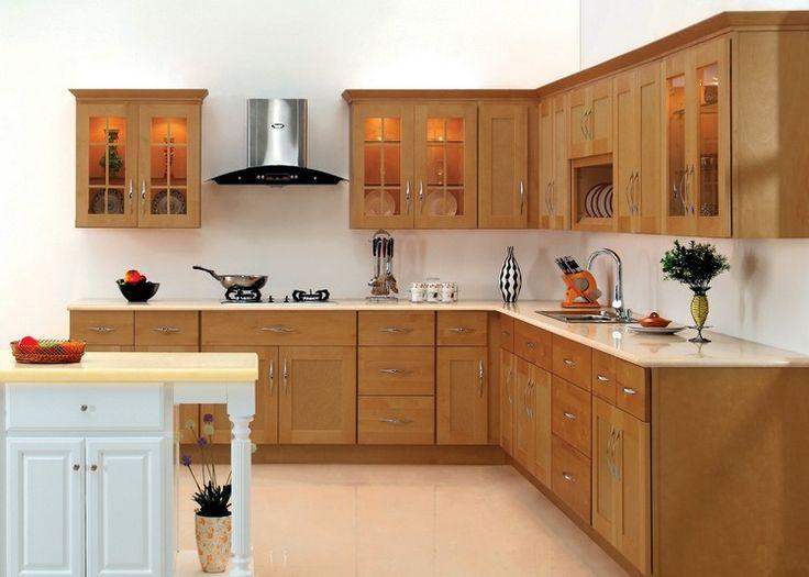 Daha büyük bir mutfak çalışma alanına sahip olmayı planlıyorsanız, L şeklinde bir mutfağa sahip olmanız sizin için ideal bir seçim olabilir. Düzenli mutfak, ahşap dolaplarında bir tan