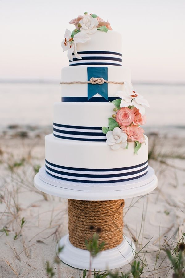 Who doesn't love stripes and flowers, especially on a wedding cake! #Nauticalcake #Nauticalwedding #Stripes #Weddingcake #Lakewedding