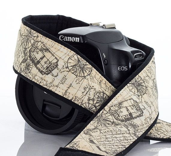 dSLR camera strap with an old world antique styled map in taupe on a creamy parchment colored background. All cotton fabrics are used on this 2 wide strap,