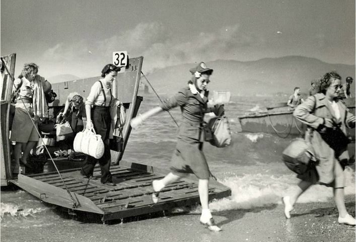 A Normandy Beach landing photo they don't show in textbooks - Brave women of the Red Cross arriving in 1944 to help the injured troops, WWII.: