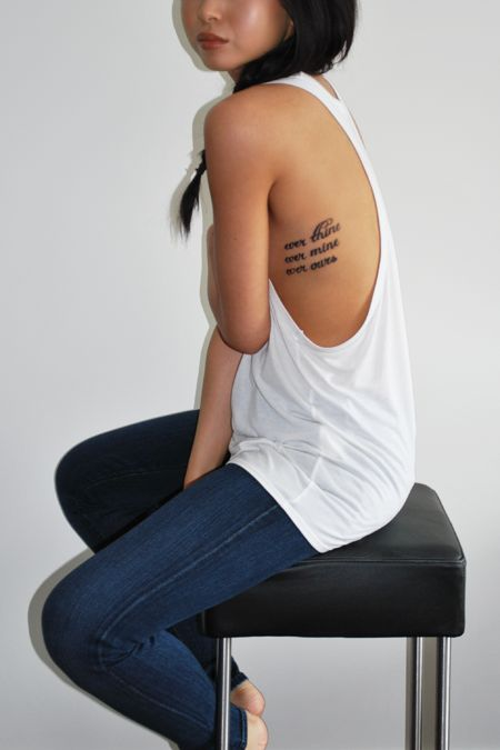 Side of rib cage tattoo placement with quote script ink for Placement of tattoos