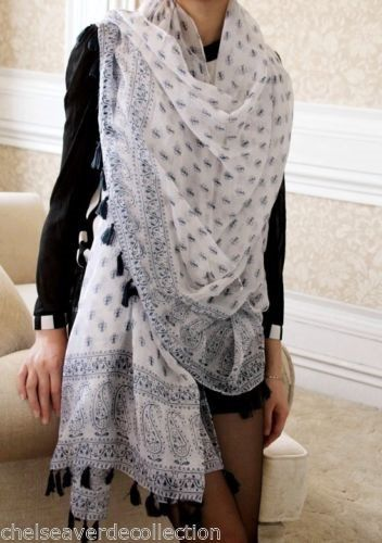 Have a very similar scarf in the same color scheme. Love wearing it. Goes with virtually anything.