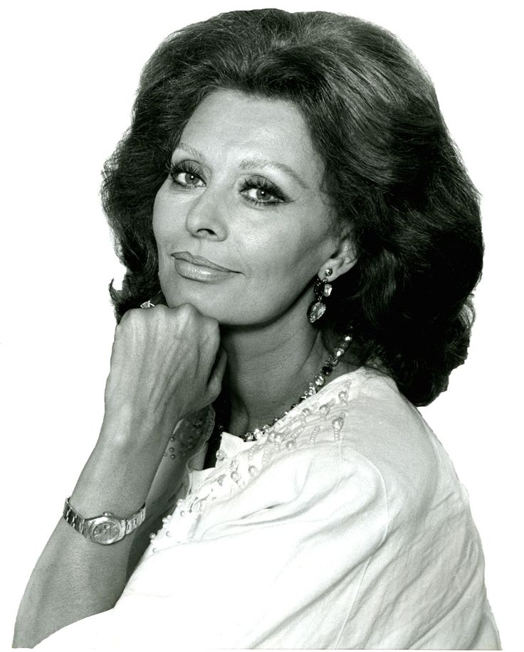 """""""Nothing makes a woman more beautiful than belief that she is beautiful."""" Sophia Loren Source – Keystone Archives Humble beginnings Sophia Loren was born in Rome, Italy on September 20, 1934. Although she would go on to be considered one of the most beautiful women in history, Sophia Loren's wet nurse remembered her as """"the ugliest child I ever saw in my life."""" Loren grew up in extreme poverty, living with her mother and many other relatives at her grandparents'... Read more."""