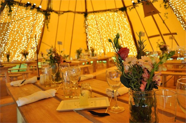 interior of party tent plus a cutey bouquet with rosmary in it!