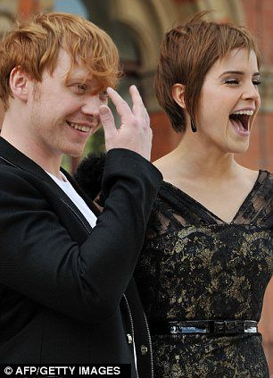 Everyone's under her spell. Emma Watson dazzles at Harry Potter photo call after being mobbed by overeager fans. I love this picture of her with Rupert Grint and many of the other pictures of the duo and the rest of the HP cast on this post.