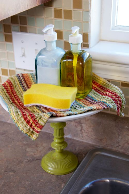 kitchen organization tips (I like the idea of matching soap containers and a crocheted cloth, just not enough room on my counter...)