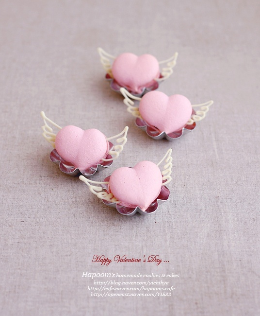 Valentine. link isn't working for me but I love the idea of making little heart shaped macarons with delicate wings inserted in the filling.