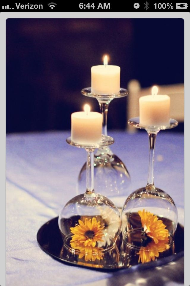 Tea light candle on upside down wine glass as part of table scape. Easy & simple. Changeable.