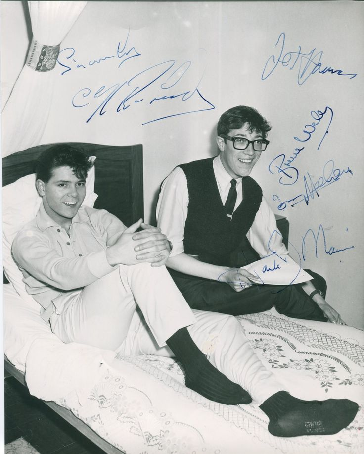 RICHARD CLIFF: (1940-     ) British Pop Singer. Vintage signed 7.5 x 9.5 photograph, the image depicting Richard seated in a full length pose on a bed with fellow musician Hank Marvin seated alongside. Signed ('Sincerely, Cliff Richard') in bold blue fountain pen ink to a clear area of the image. Also signed by The Shadows individually, comprising Hank Marvin, Bruce Welch, Jet Harris and Tony Meehan. All have signed in blue fountain pen inks to clear areas of the image.